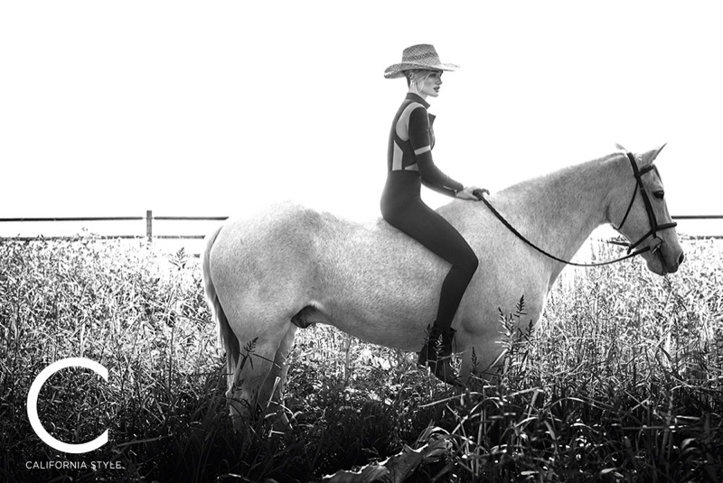 Posing on a horse, Rosie Huntington-Whiteley models Balmain bodysuit and leggings with Modern Vice boots