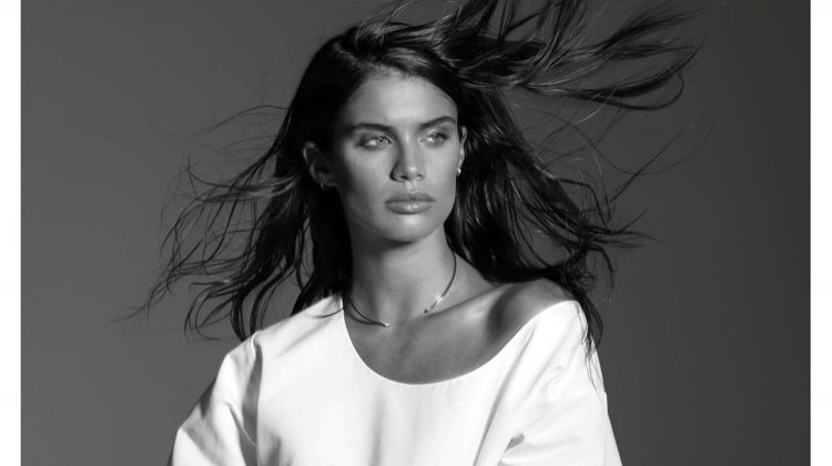Photographed in black and white, Sara Sampaio models The Row top and Araks bikini bottoms