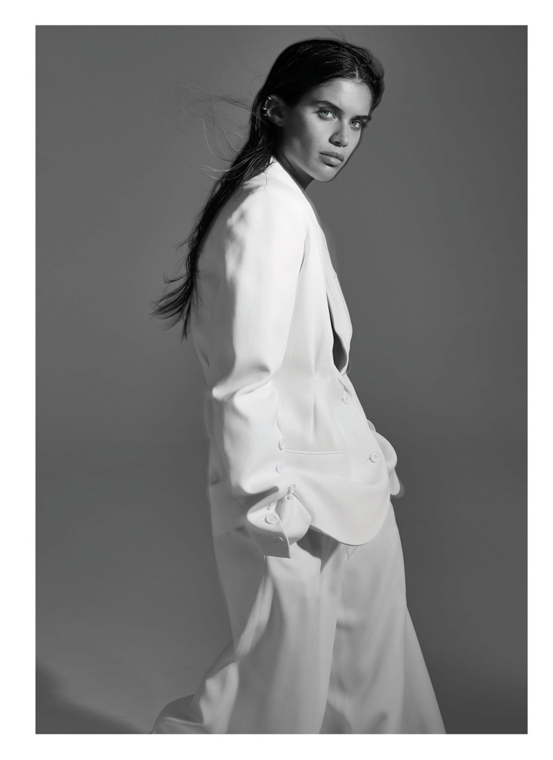 Model Sara Sampaio suits up in white jacket and pants from Michael Kors Collection