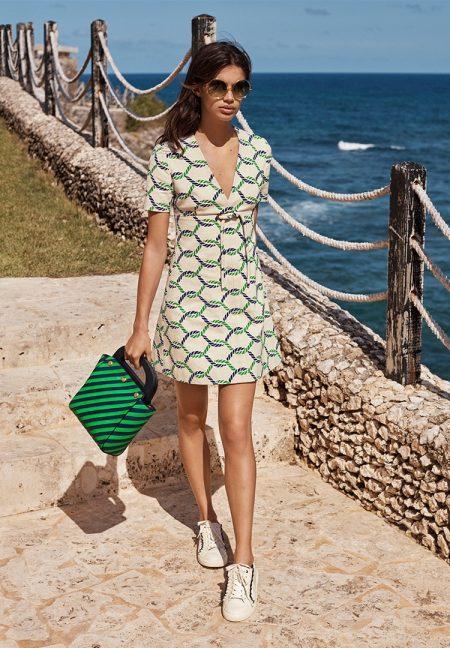 Sara Sampaio models Tory Burch printed dress and handbag