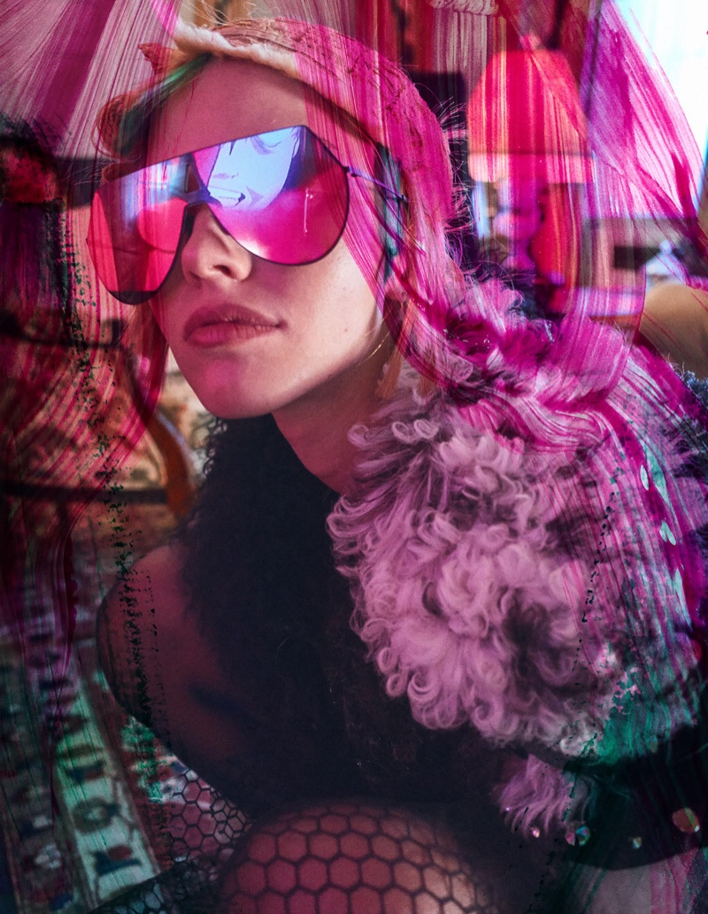 Sasha Luss models pink sunglasses with shearling jacket