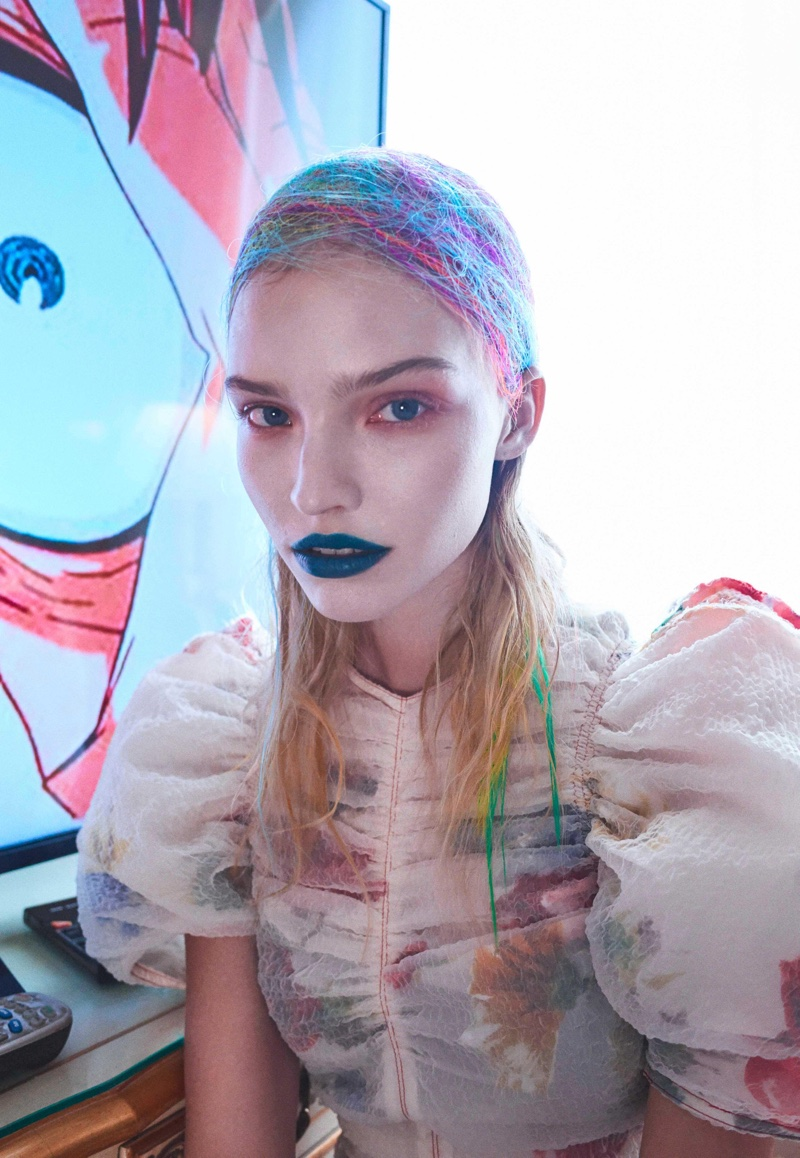 Photographed by Hunter & Gatti, the model poses in eclectic styles
