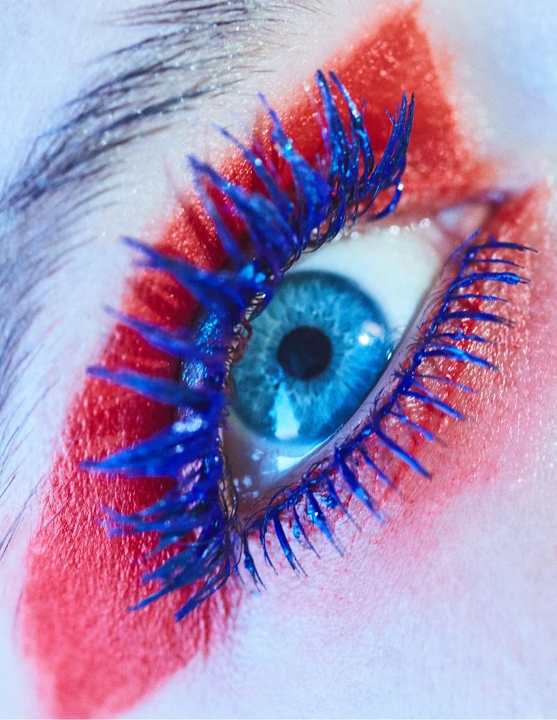 Sasha Luss models blue mascara and red eyeshadow