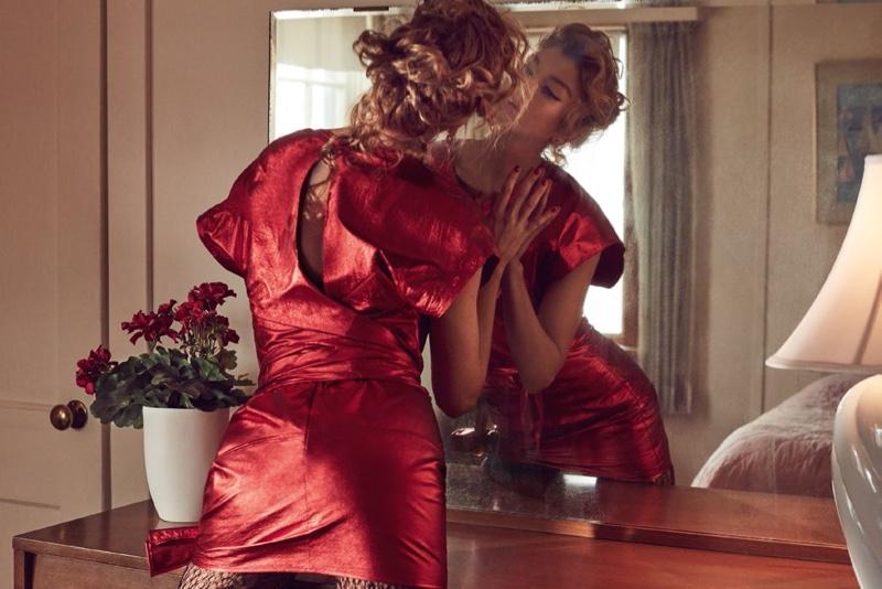 Looking in a mirror, Stella Maxwell models red mini dress