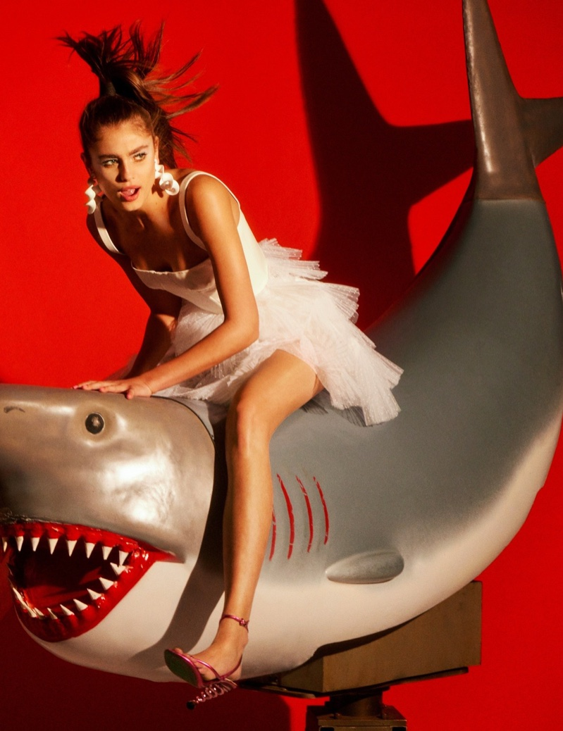Posing on a shark, Taylor Hill models tulle Dior dress