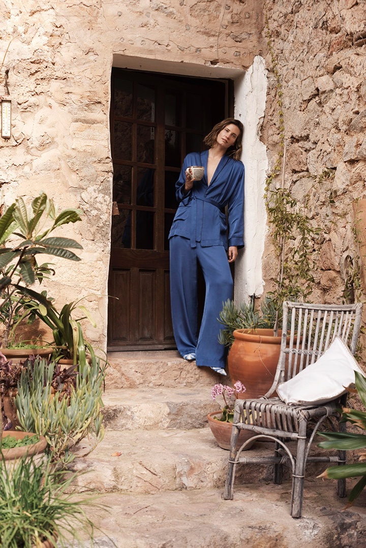 Looking straight from the bed, Drake Brunette poses in Zara robe and pants