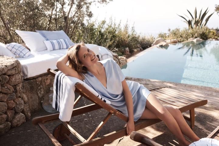 Posing poolside, Drake Burnette wears Zara Home mini dress