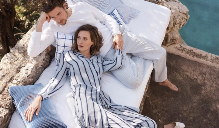 Lounging outdoors, Drake Burnette wears striped pajama separates from Zara Home