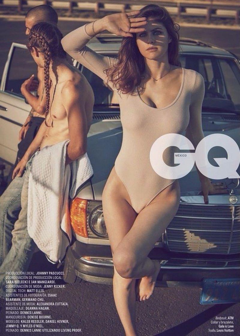 Posing on the hood of a car, Alexandra Daddario wears ATM bodysuit