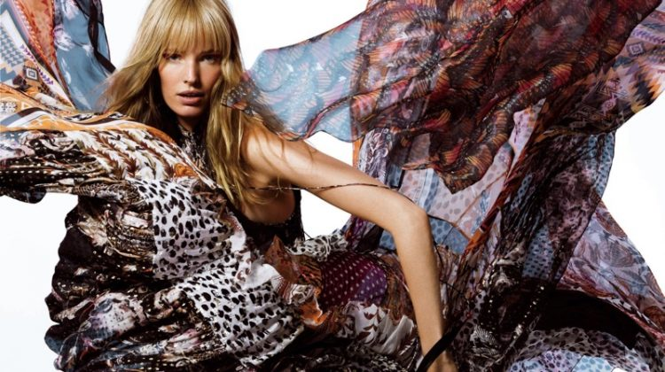 Striking a pose, Alisa Ahmann models Etro printed dress and Erickson Beamon jewelry