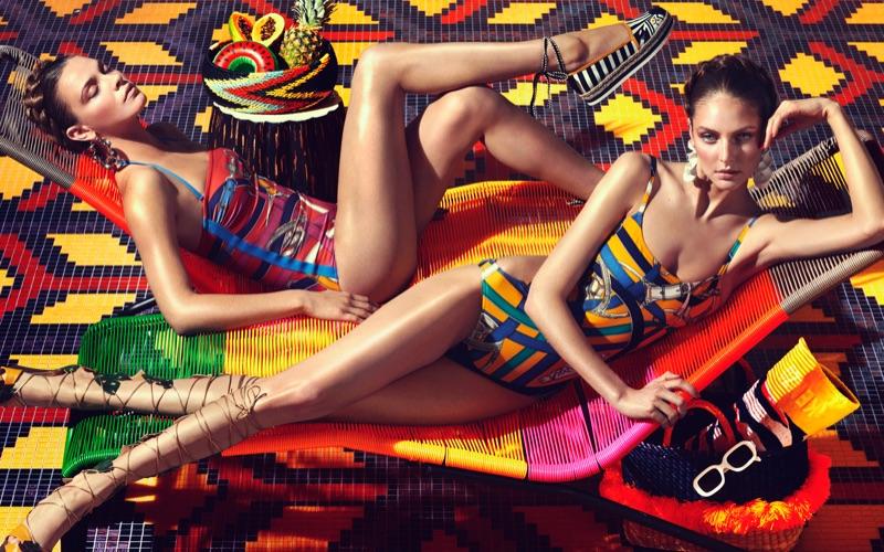Xannie Cater models Hermes cotton jersey swimsuit, Furla espadrilles and Altuzarra earrings. Auguste Abeliunaite poses in Hermes cotton swimsuit, Charlotte Olympia heels and Altuzarra earrings.
