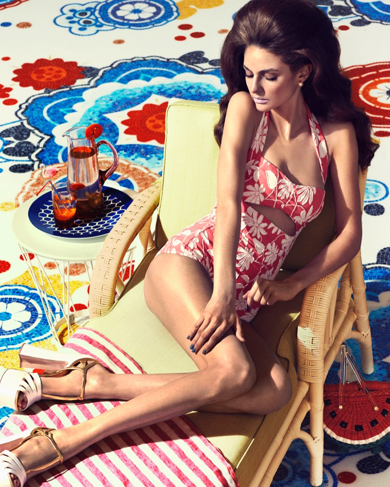 Looking retro chic, model wears Miu Miu cotton swimsuit and platform sandals with Dior earrings