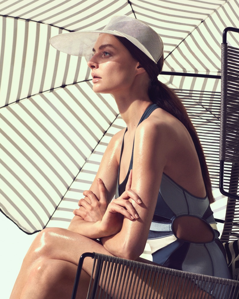 Auguste Abeliunaite wears Isabel Marant one-piece swimsuit and Dior hat