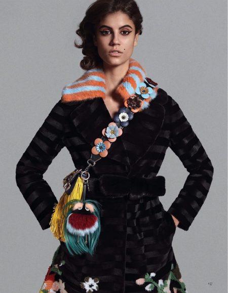 Antonina Petkovic models Fendi mink coat and fringe bag with floral embellished guitar strap