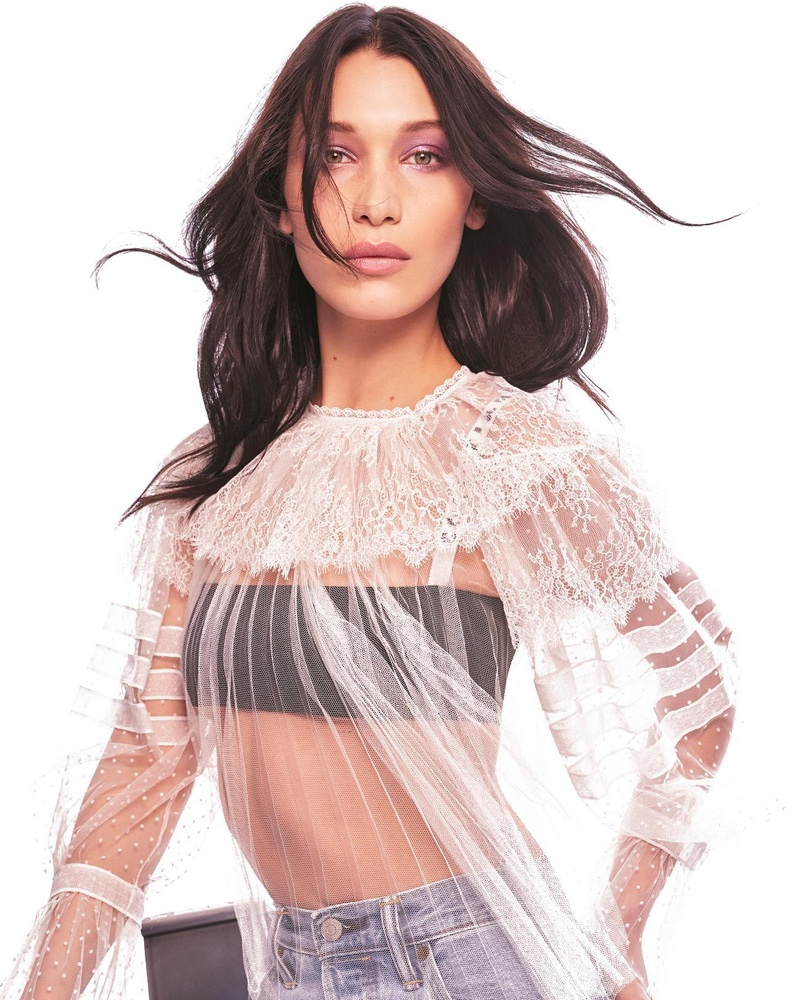 Model Bella Hadid wears lace Dior top and bandeau bralette