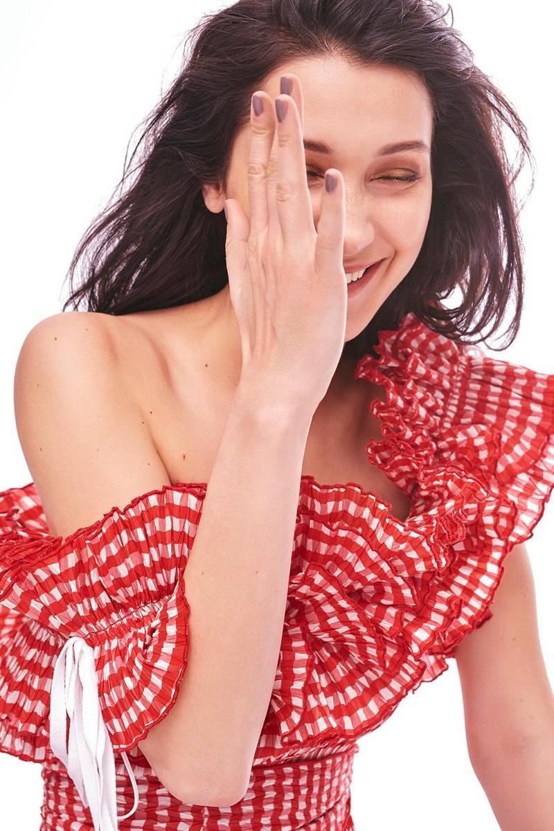 Model Bella Hadid wears gingham print top