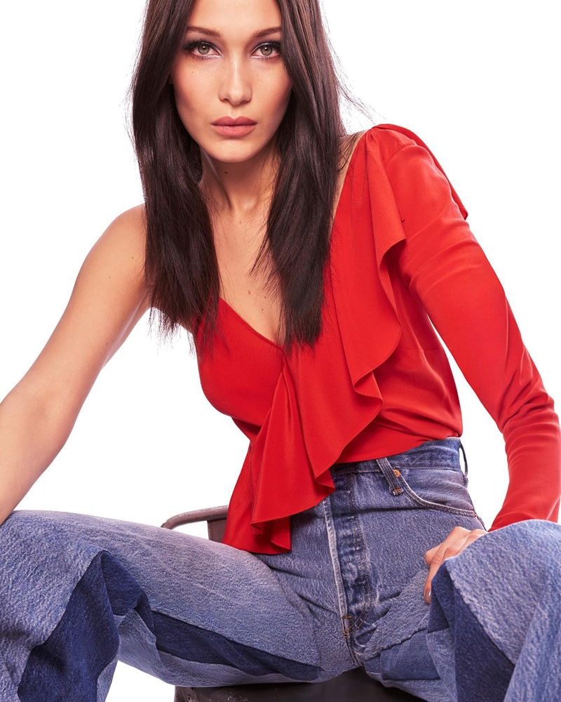 Bella Hadid poses in one-sleeve top and high-waisted jeans