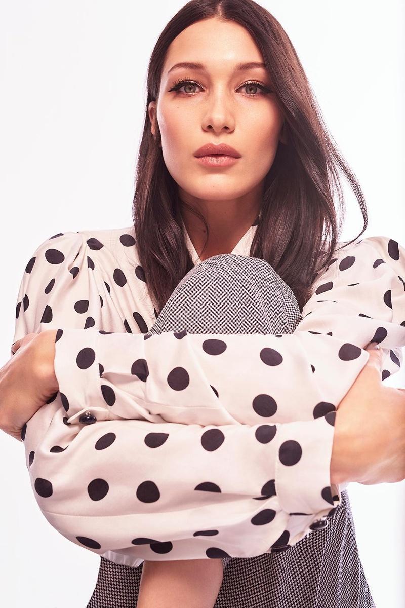 Bella Hadid poses in polka dot print top