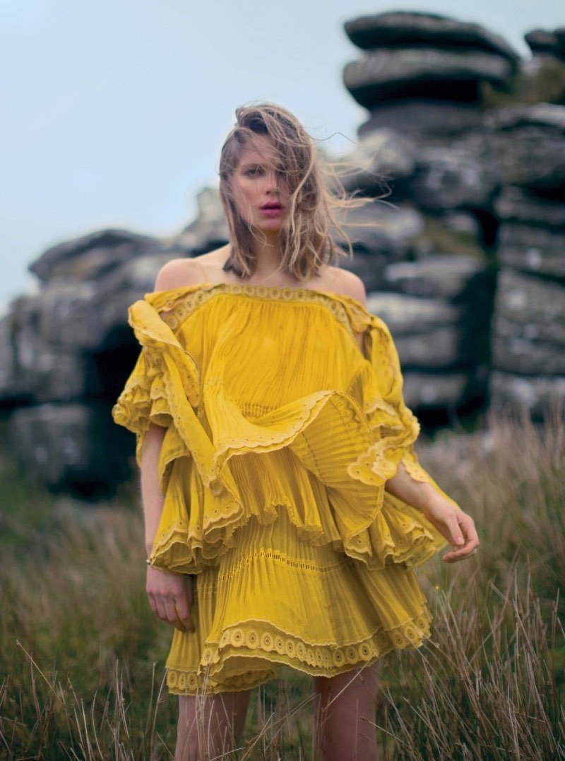 Standing out in yellow, Caroline Brasch Nielsen models Chloe silk organza top and skirt