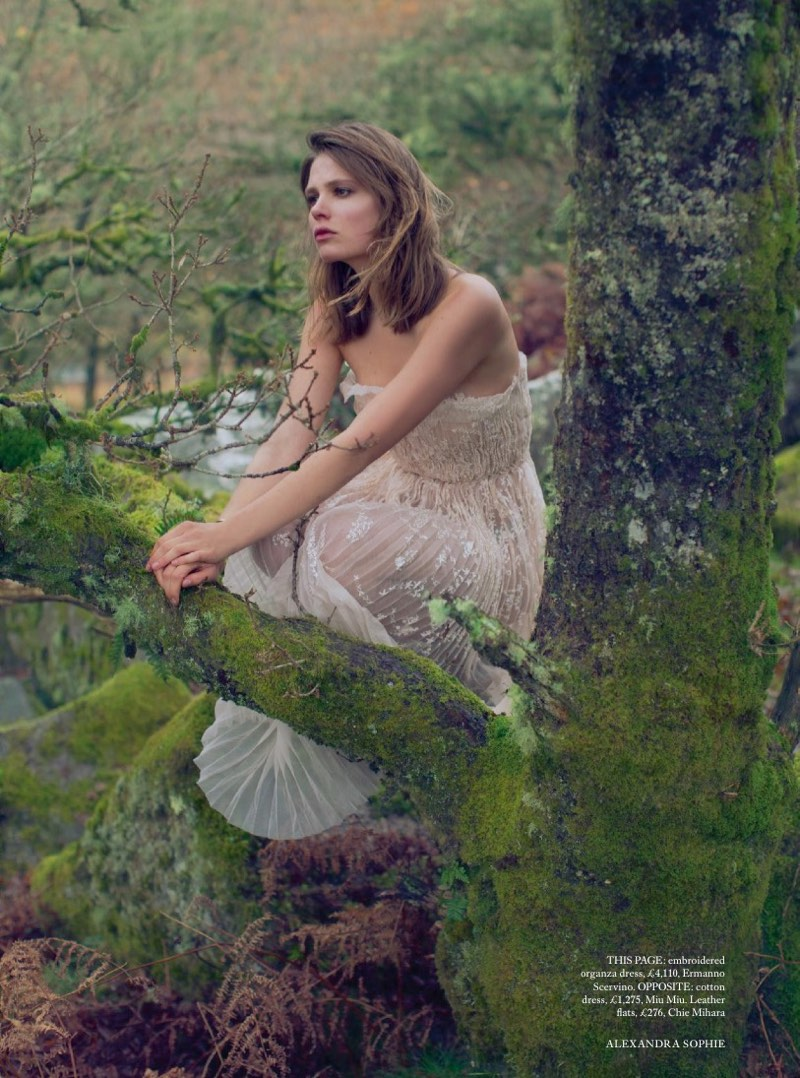 Posing outdoors, the model wears embroidered organza dress from Ermanno Scervino