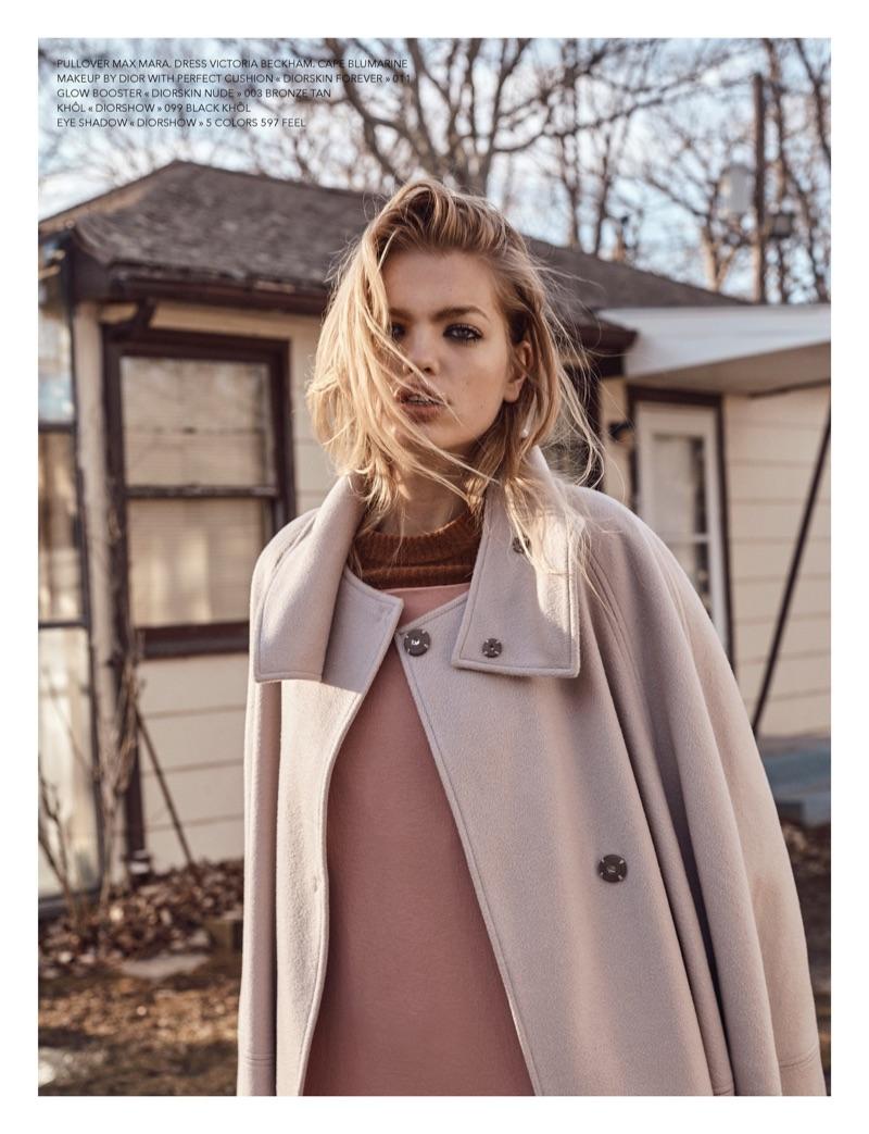 Model Daphne Groeneveld wears Max Mara sweater, Victoria Beckham dress and Blumarine cape
