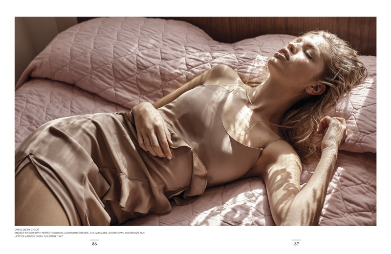 Posing in bed, Daphne Groeneveld wears See by Chloe dress with ruffles