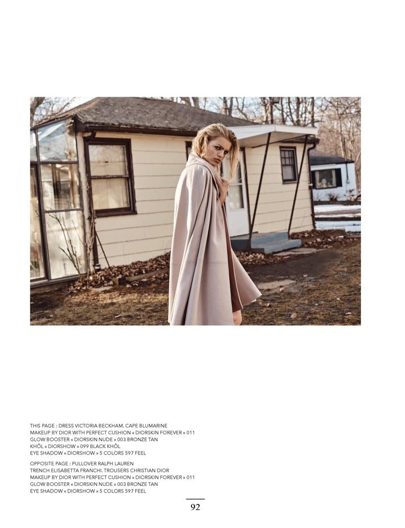 Posing outdoors, Daphne Groeneveld models Victoria Beckham dress with Blumarine cape
