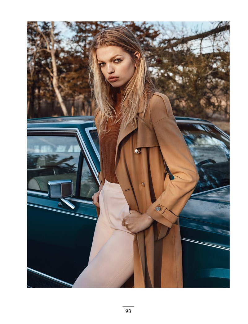 Daphne Groeneveld poses in Ralph Lauren sweater, Elisabetta Franchi trench and Dior trousers