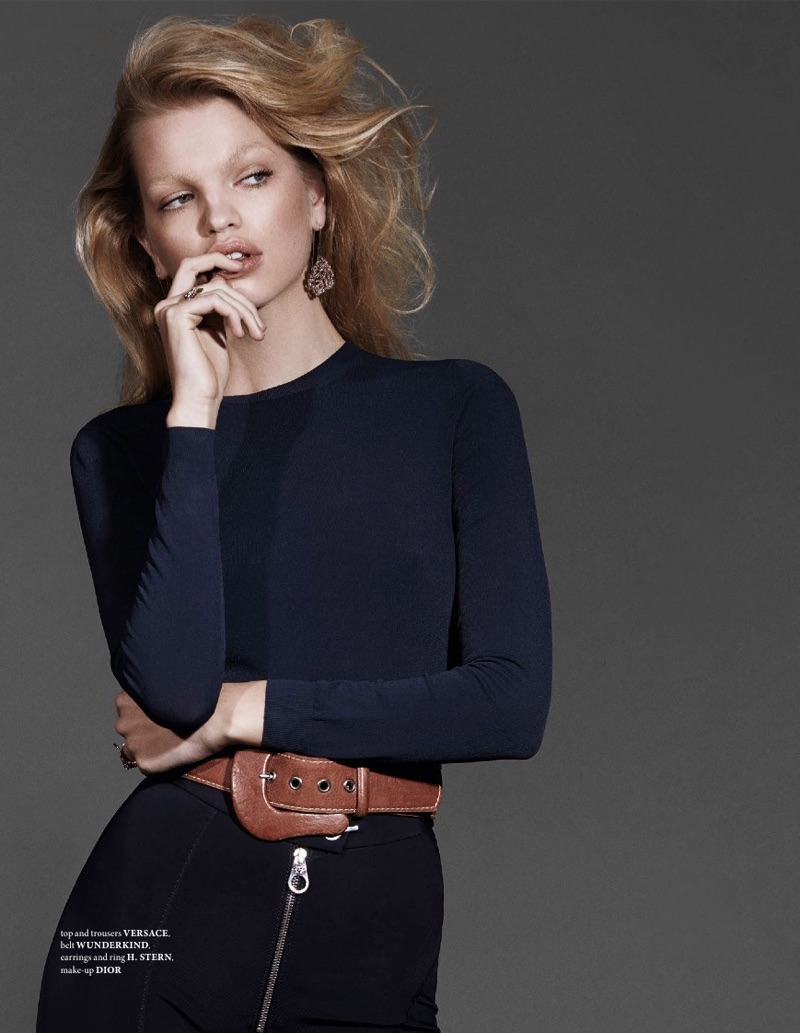 Model Daphne Groeneveld wears Versace top and pants with Wunderkind belt and H. Stern jewelry