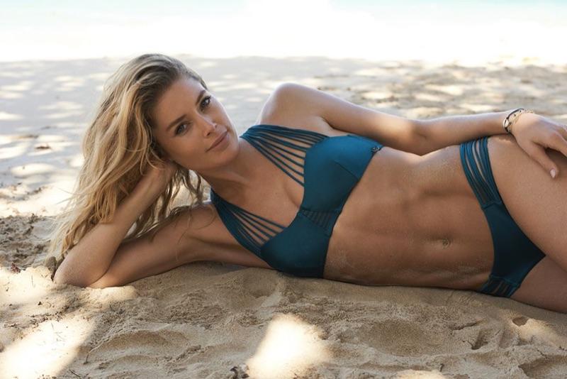 Posing in the sand, Doutzen Kroes wears teal strappy bikini set
