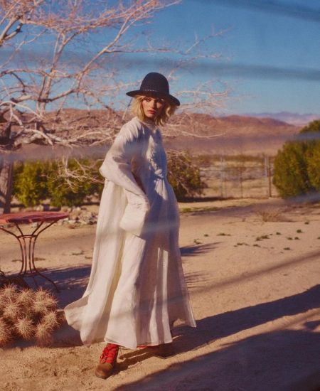 Layering up in white, Edita Vilkeviciute poses in Joseph dress (worn as jacket), Valentino maxi dress and Blugirl hat