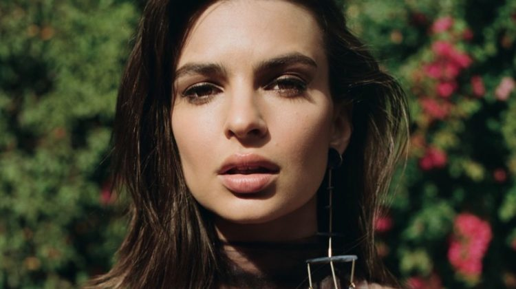 Model Emily Ratajkowski wears strapless bralette with dangling earrings