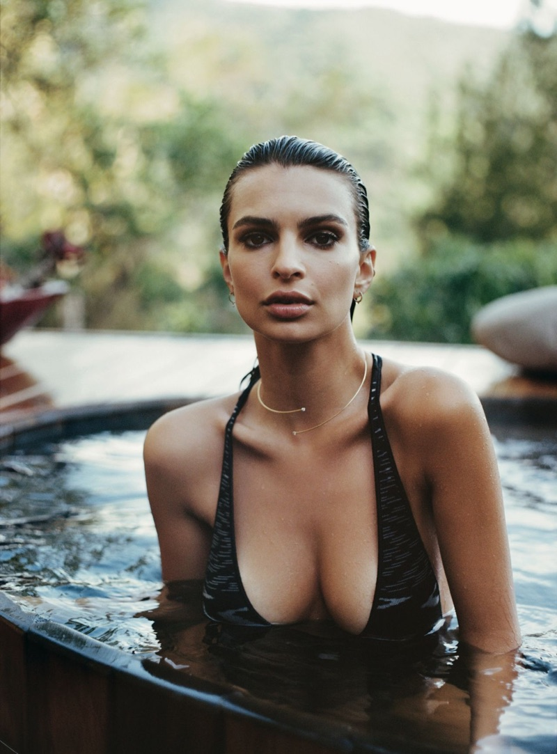 Taking a dip into the pool, Emily Ratajkowski models plunging swimsuit