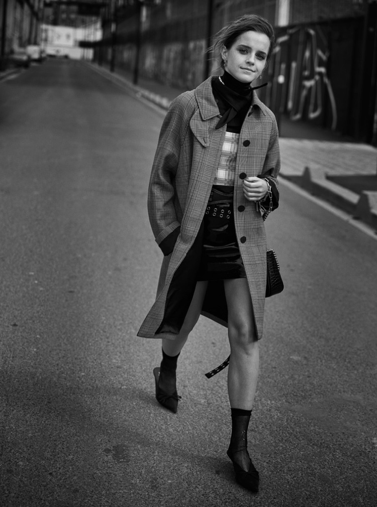 Taking a stroll, Emma Watson poses in Louis Vuitton coat, Prada top and UNIF skirt