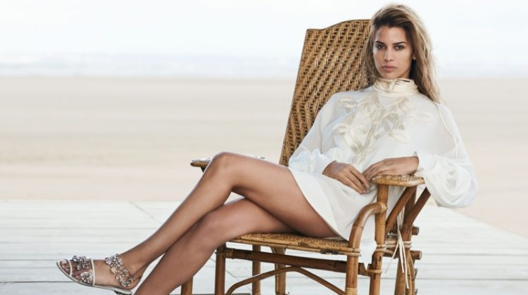 Kenya Kinski Jones poses in embellished tunic and sandals from Ermanno Scervino's spring 2017 campaign