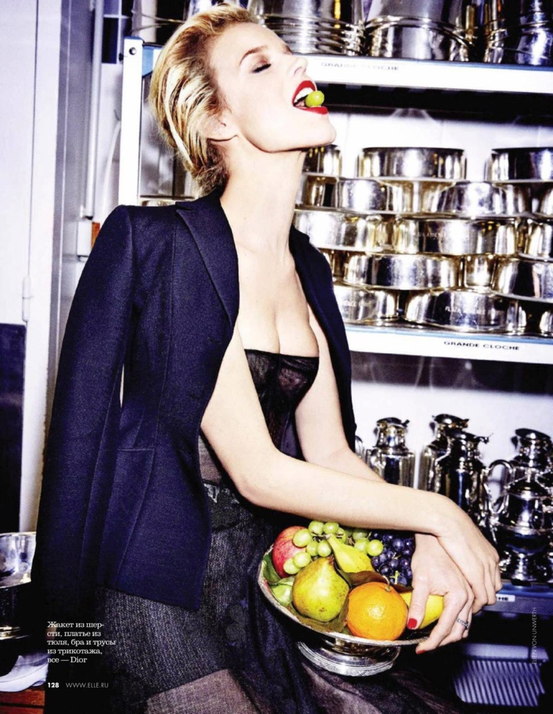 Posing with a bowl of fruit, Eva Herzigova wears Dior blazer and strapless dress