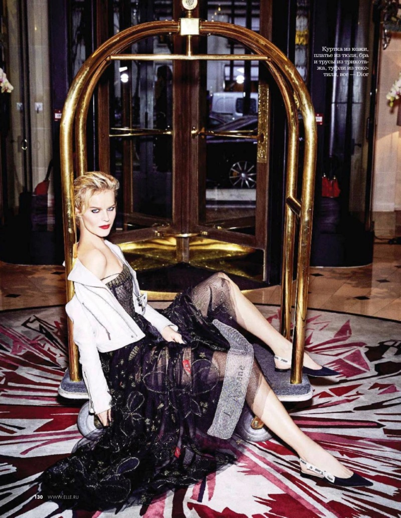 Model Eva Herzigova poses in Dior moto jacket, embellished dress and flats