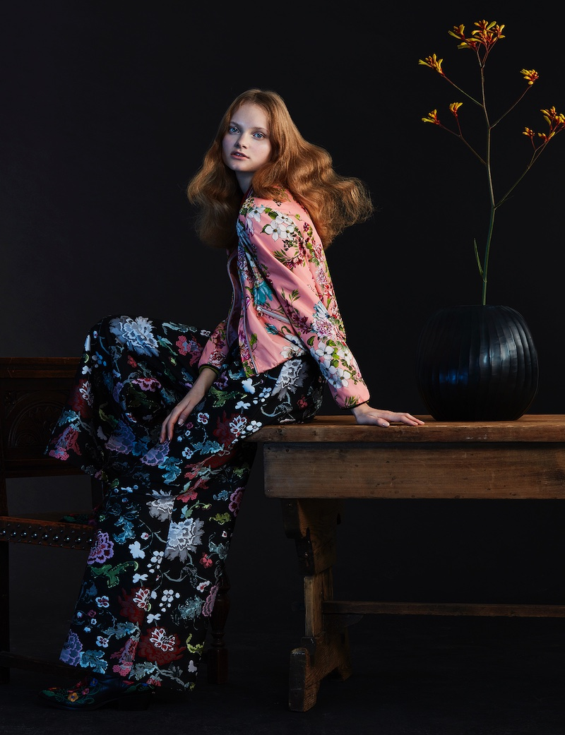Wearing florals from top to bottom, the model strikes an elegant pose