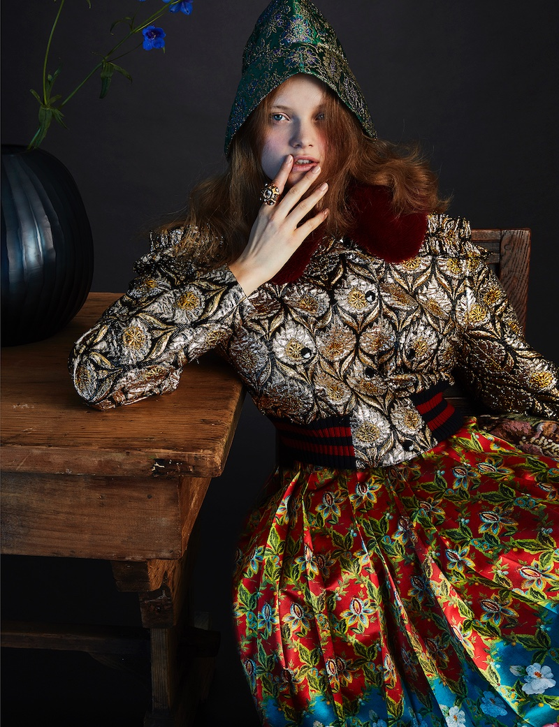 Valou Weemering poses in Gucci hooded jacket and pleated skirt
