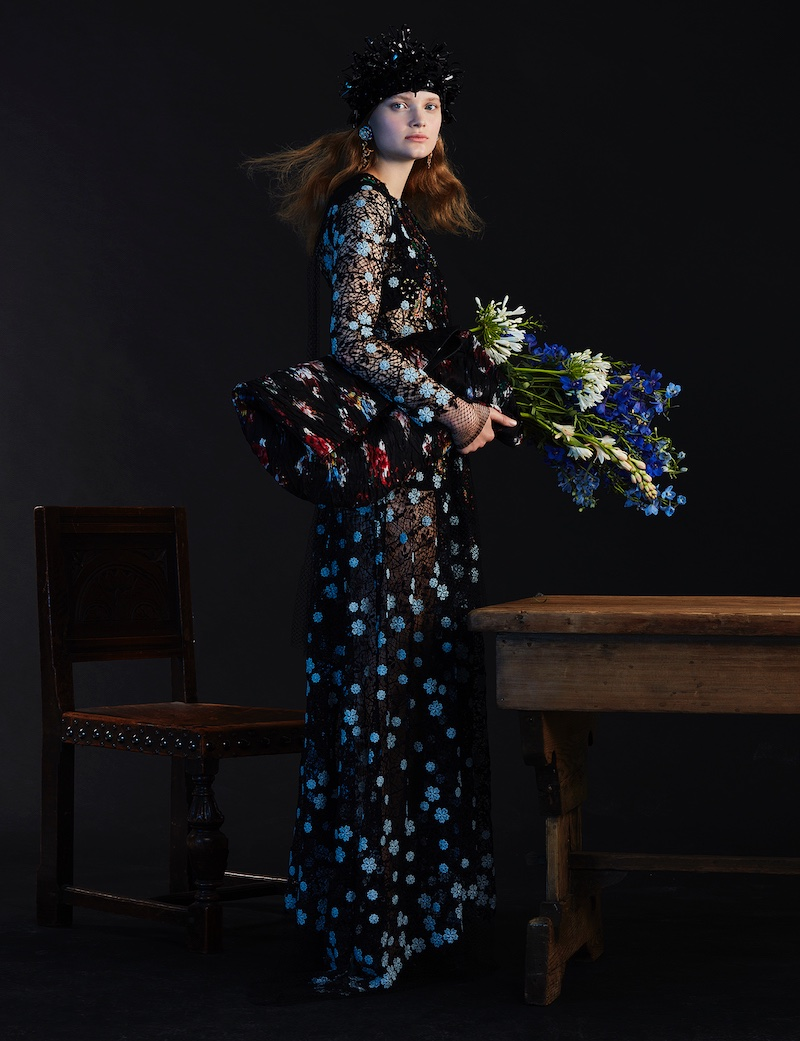 Looking true blue, the model wears floral embellished gown
