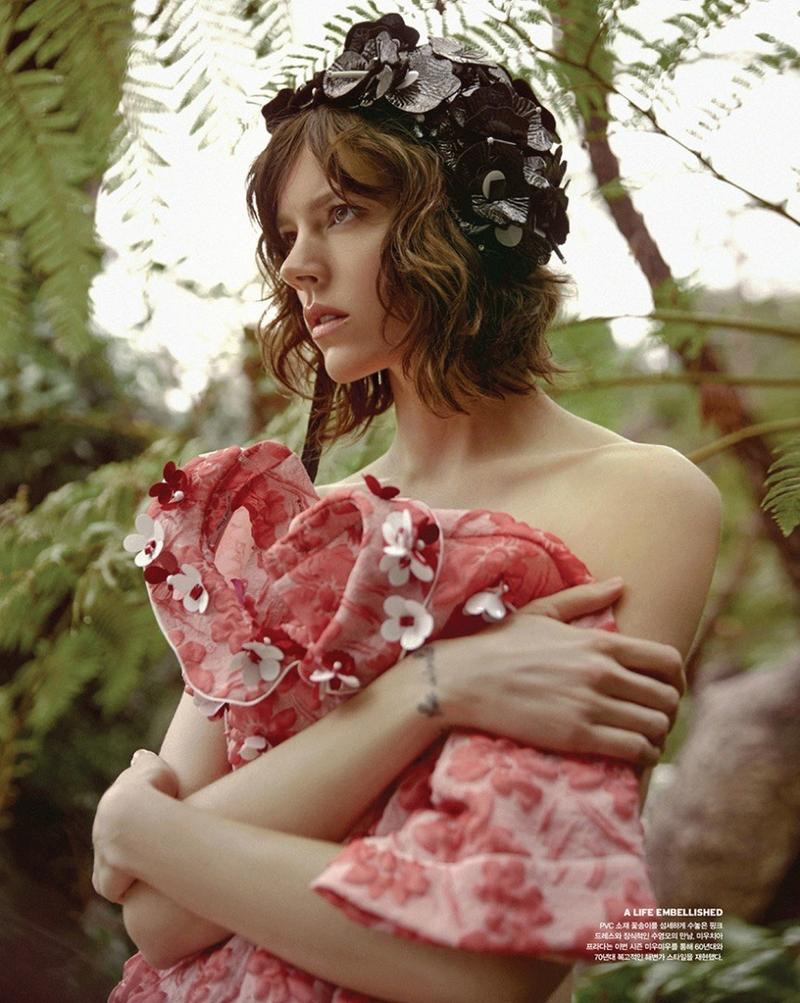 Model Freja Beha Erichsen poses with Miu Miu wrap dress and embellished cap