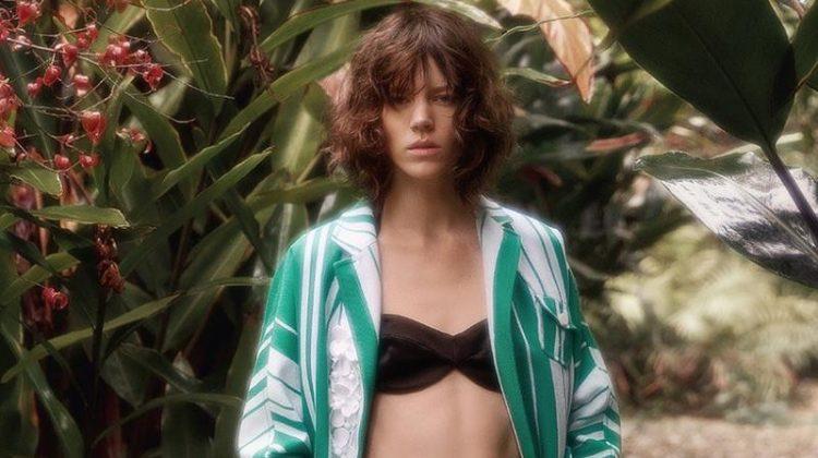 Freja Beha Erichsen poses in Miu Miu coat, strapless swim top and shorts