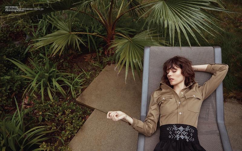 Lounging outside, Freja Beha Erichsen models Miu Miu shirt and high-waist briefs