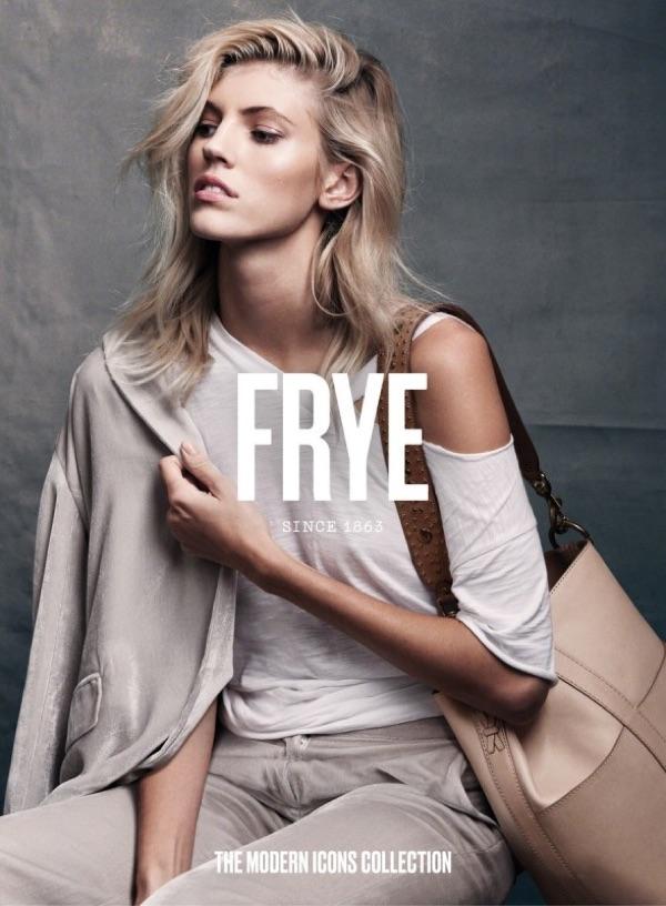 Devon Windsor poses with the FRYE Ilana Bucket Hobo Bag