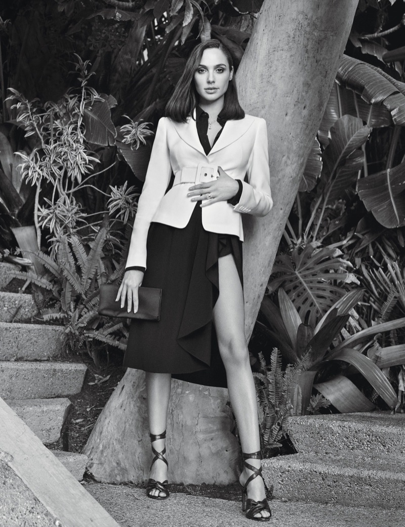 Gal Gadot poses in Michael Kors Collection jacket, blouse and skirt with Altuzarra sandals