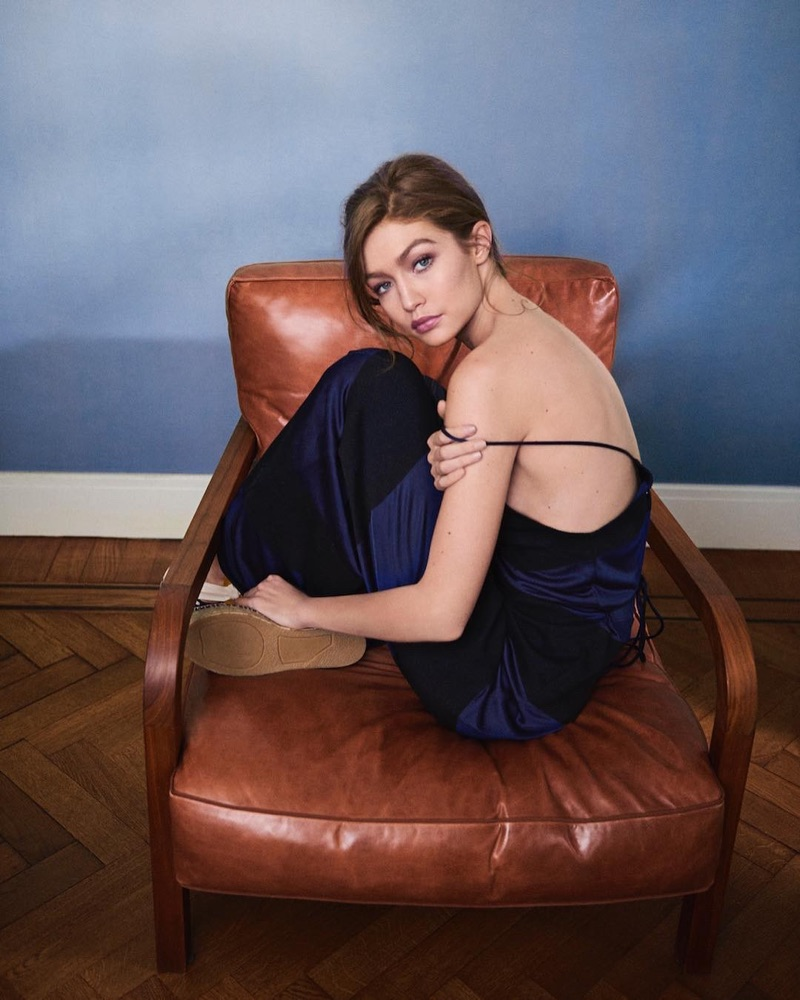 Model Gigi Hadid poses in TommyxGigi dress and shoes