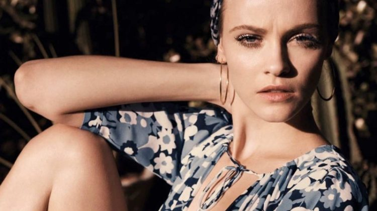 Ginta Lapina lounges in Michael Kors silk dress and Norma Kamali turban