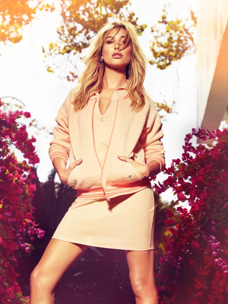 Looking pretty in pink, Hailey Baldwin poses in bomber jacket and knit dress from Guess' spring-summer 2017 campaign