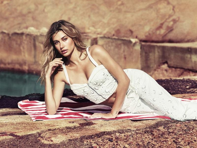 Hailey Baldwin poses in Guess Sabrina Embellished Bustier Top and Sabrina Embellished Relaxed Jeans