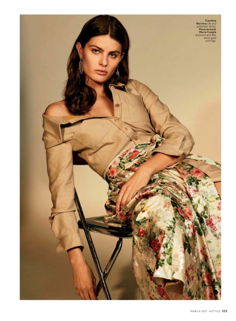 Model Isabeli Fontana poses in Carolina Herrera silk and polyester dress with floral prints. Earrings by Forevermark Maria Canale.